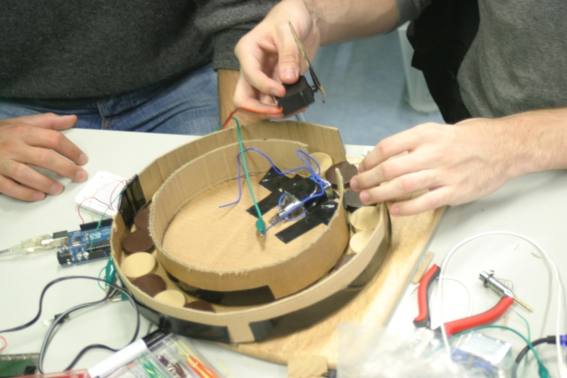 Modeling a design concept out of cardboard to ensure the electronics fit into the enclosure